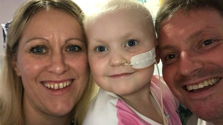 Arabella Scannell pictured with her parents Mark and Ellie. Picture: SCANNELL FAMILY