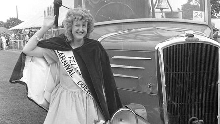 The Carrnival Queen stands proudly beside an old firefighting vehicle in 1987 Picture: ARCHANT