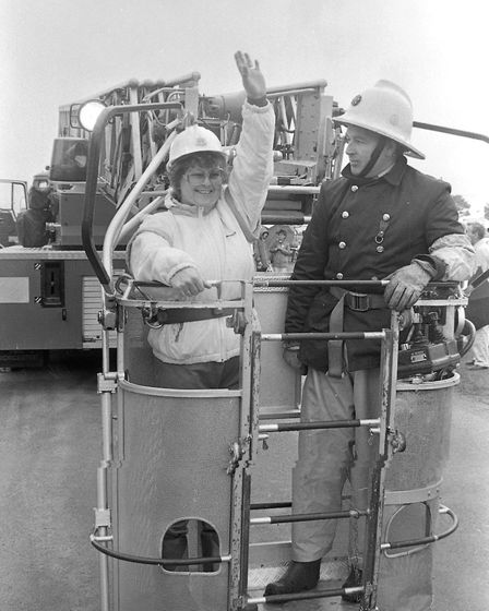 A firefighter taking someone up in a turntable ladder Picture: ARCHANT