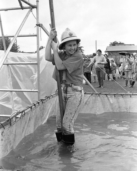 A youngster sliding down a firefighter's pole at the Firefighters Rally in 1987 Picture: ARCHANT