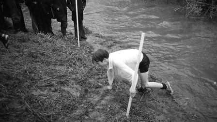 A student uses the poles to help him up the hill for one last push to the finishing line Picture: A