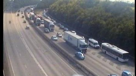 The accident, involving four cars, is blocking the A14, with paramedics, firefighters and police off