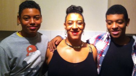 A young Tavis Spencer-Aitkens with his mother and twin brother Picture: CONTRIBUTED BY FAMILY
