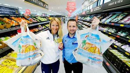 Olympic gold medallist Saskia Clark and store manager Joe Lawrence at the brand new Aldi in Martlesh