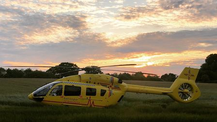An air ambulance is at the scene of the crash in Wherstead Road Picture: NSRAPT