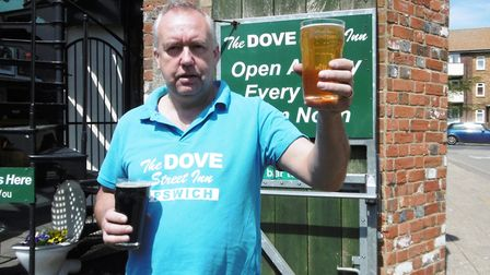 Thousands of pints at the Dove Street Inn May Beer Festival. Landlord Ady Smith raises a glass of tw