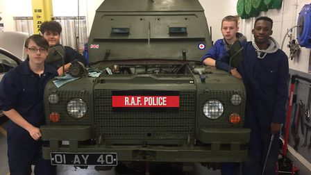 Students from Suffolk New College with the armoured car. Picture: JOHN NICE