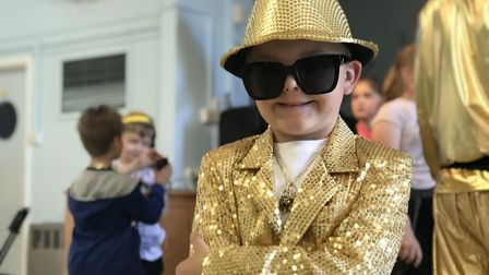 Pupils at the school dressed up in bling to mark the rapper's visit Picture: ELLA WILKINSON