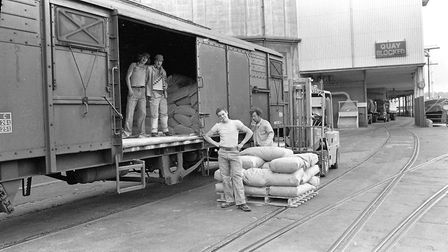 A group of young men hard at work unloading goods onto the docks Picture: OWEN HINES