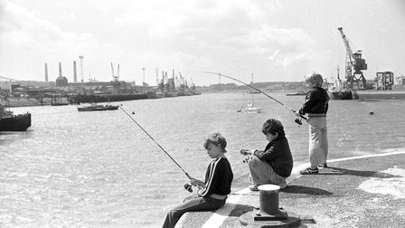 Youngsters fishing at the Ipswich docks in 1979 Picture: OWEN HINES