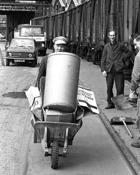 Man looking cheerful as he balances a heavy load on his wheelbarrow at the Ipswich docks Picture: O