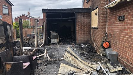 Mr Squirrell's garage. The secon door was also removed by firefighters, revealing the extent of the