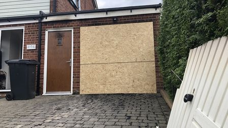 The garage door on Mr Squirrell's home was ripped off by firefighters on June 3 as they battled a bl