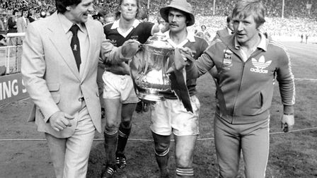 Ipswich Town manager Bobby Robson (left) and coach Cyril Lea escorted by players David Geddis and ca