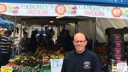 """Mick Catchpole beside """"Catchey's"""" fruit and veg stall on Ipswich Market. Picture: PAUL GEATER"""