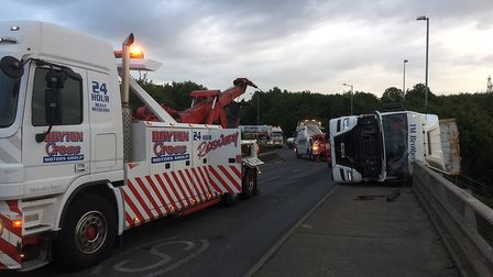 Recovery vehicles are on scene at the site of an overturned lorry at Copdock interchange Picture: NS