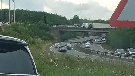Chris Punton's partner took this photo of the lorry hanging over the A14 at Copdock as he was drivin