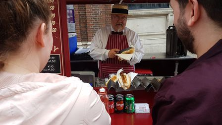 Customers get ready to collect their lunch from the Hot Sausage Co in Ipswich