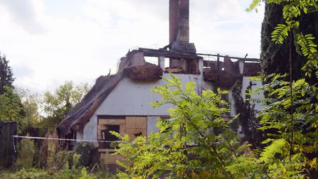 Burnt out remains of the derelict thatched cottage after the fire in 2017 Picture: SARAH LUCY BROWN