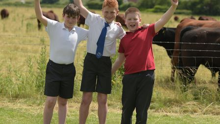 Lucas, Tom and Charlie having fun on Suffolk Day Picture: SARAH LUCY BROWN