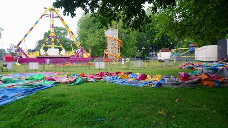 Deflated fun: A funfair sits deflated and empty in the early morning Picture; ARCHANT