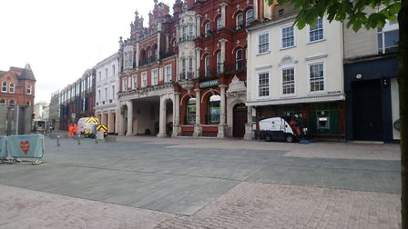 Making preparations: Council workers prepare the town centre for another busy day Picture: ARCHANT