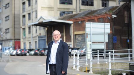 David Ellesmere in front of the Burton buildings Ipswich Borough Council acquired in 2015. Picture: