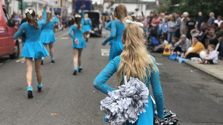 Thousands of people lined the streets to watch the colourful floats, musicians and dancers perform a