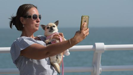 A lady takes a selfie on the pier Picture: SARAH LUCY BROWN