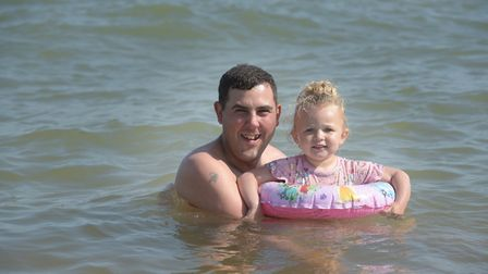 Lee Parfitt and Amber Woollard cool off in the sea Picture: SARAH LUCY BROWN