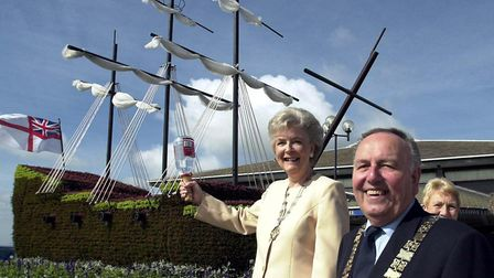Cyril and Jean Webb with the galleon of flowers 3D floral sculpture outside Felixstowe Leisre Centre