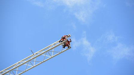 Workers dismantle the crane at The Winerack in Ipswich Picture: SARAH LUCY BROWN