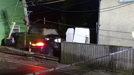 A car has crashed intop a telegraph and a house in Tattingstone, near Ipswich Picture: ADAM HOWLETT