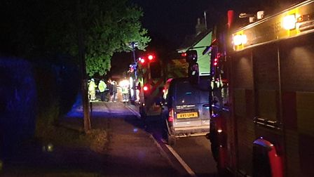 Police and fire crews remain at the scene of the crash in Tattingstone Picture: ADAM HOWLETT