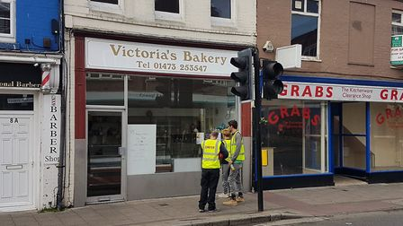 No lunch today? Three workers looking in Victoria's Bakery discover they will have to go around the