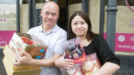 Shop owner Yixuan Cheung and husband Tak Cheung are busy stocking the shelves ready to open Go East