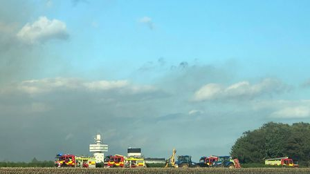 Fourteen fire crews are now at the scene of a huge heathland fire in Kesgrave. Picture: ARCHANT
