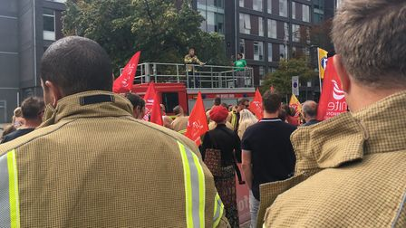 The crowd listen to speeches protesting against cuts to the Fire and Rescue Service in Suffolk Pic