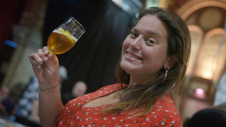 Sue Ward with Pollen Power brewed by Mr Bees Brewery. Picture: SARAH LUCY BROWN