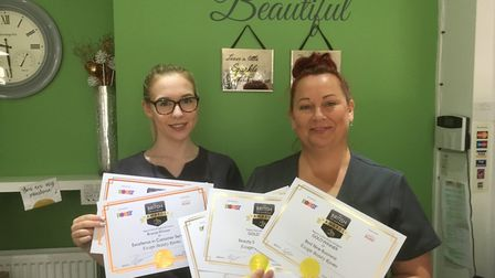 Victoria Burrows and Anita Lord with the five British Hair & Beauty Awards certificates at Escape B