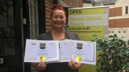 Owner Anita Lord of Escape Beauty Rooms with her three gold British Hair & Beauty Awards certificate