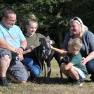 Blue with his new family. L-R Paul, Emilija, Jacob and Egle Tricker Picture: SARAH LUCY BROWN