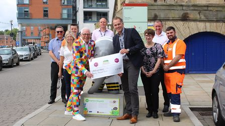 Norman Llyod, Paul Ager and ABP staff with a cheque for �20,000 for Elmer's Big Parade Suffolk which