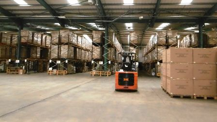 Products stacked high at Monumart's Ipswich warehouse and distribution centre. Goods are sold on the