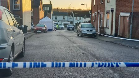 Forensic officers examining the area of Turin Street and Kenyon Street in Ipswich as part of the mur
