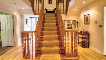 The grand staircase of the main house is Canadian oak and creates an impressive first impression whe