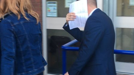 Jon Bullimore shields his face after leaving Suffolk Magistrates' Court Picture: ARCHANT