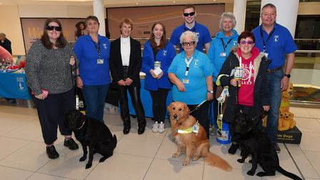 Hannah Young, left, with other guide dog owners and volunteers at Sailmakers Shopping Centre. Pictur