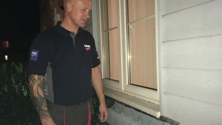 Andrew Bennett surveys the damage at his home after thieves stole lead flashing Picture: ARCHANT