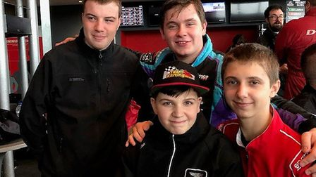 Jack Ferguson (right) with Team Racing with Autism, who took the silver medal in their classificatio